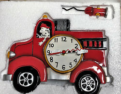 Collectible rare Big Red Fire Truck wall clock with swinging pendulum