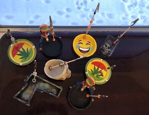 Long and medium roach clips plus roachtrays