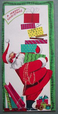 Santa carrying stack of presents CHRISTMAS VINTAGE GREETING CARD *M