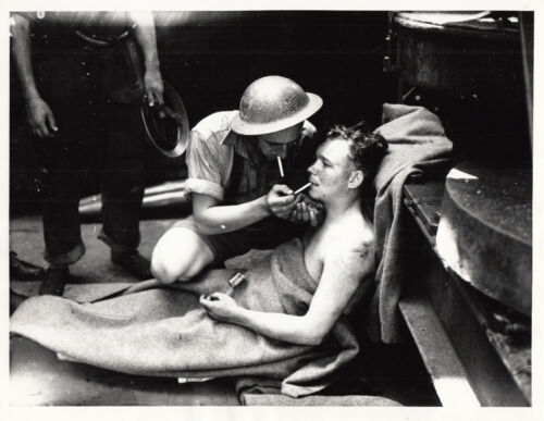 H.M.S. MANCHESTER WOUNDED SAILOR AFTER BEING TORPEDOED - 1942