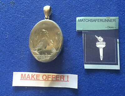 LARGE C. 1880 AESTHETIC MOVEMENT LOCKET WITH ENGRAVED STORK TO THE FRONT