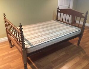 Antique spool bed with mattress