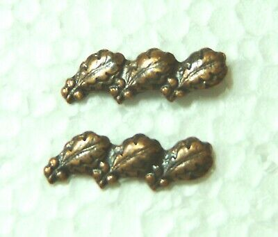 US Medal device attachment, 2 triple bronze oak leaf clusters for ribbon bars