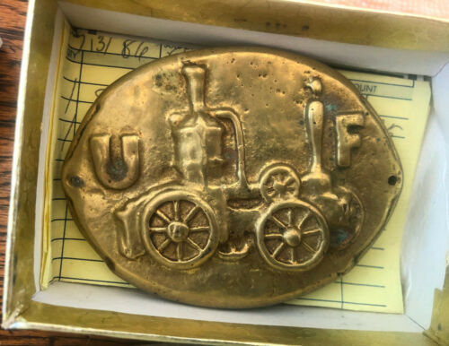 Solid brass belt buckle inspired by a firemark with a steam fire engine.