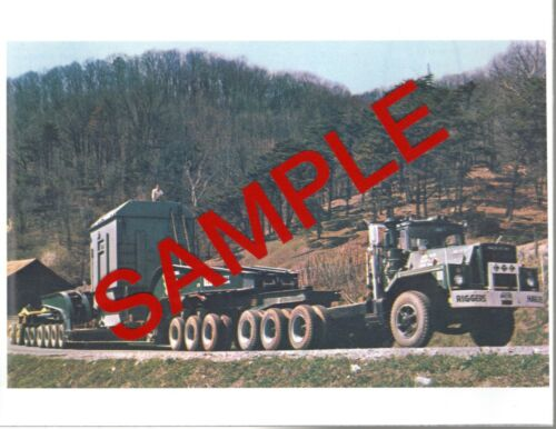 Photo - Mack DM-800 with 300 ton Talbert trailer.