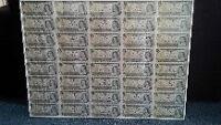 Uncut Canadian one dollar bills -Collectors item!