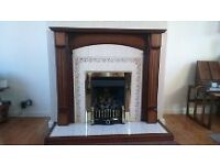Gas fire with dark surround and tiles hearth and back
