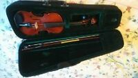 A 1/4 size violin for sale