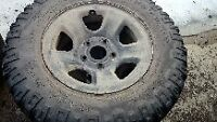 265/17R70 Mud/snow tires and rims. 5 hole from dodge pick up2012