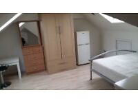 Large Loft Room with study table to let for single professional £500.00 PCM all inclusive