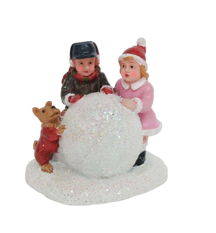 st nicholas square village kids building snowman New