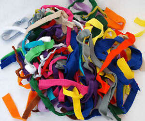 BAG-OF-RIBBON-SHAPED-FELT-OFF-CUTS-100g