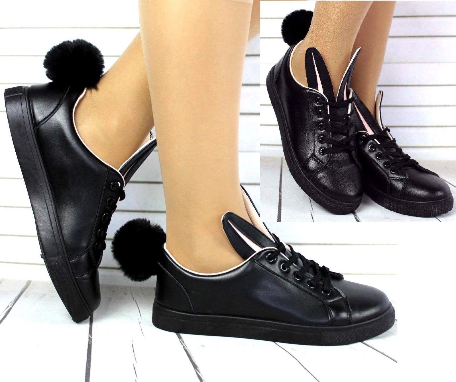 black pom pom trainers