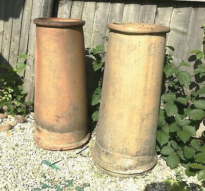 PAIR OF VICTORIAN PALE TERRACOTTA COLOURED CHIMNEY POTS