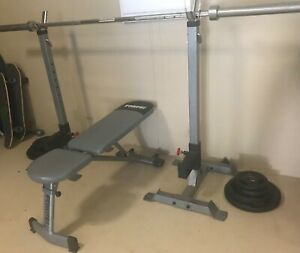 Weight lifting bench, squat rack and weights