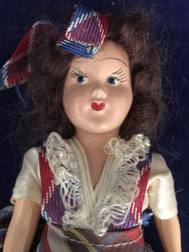 Vintage 7.5 Inch Plastic Doll In Plaid Dress - $16.99