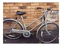 Ladies Raleigh Collette vintage town bike with wicker basket.