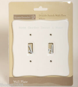 White plastic light switch covers