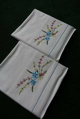 Pair vintage UNUSED white cotton pillowcases with floral embroidery.