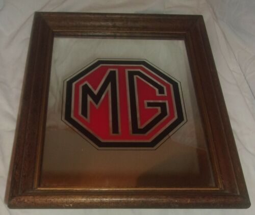 SMALL MG AUTO LOGO FRAMED MIRROR IN GOOD CONDITION WITH LIGHT WEAR