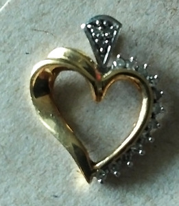 Gold and diamonds heart pendant