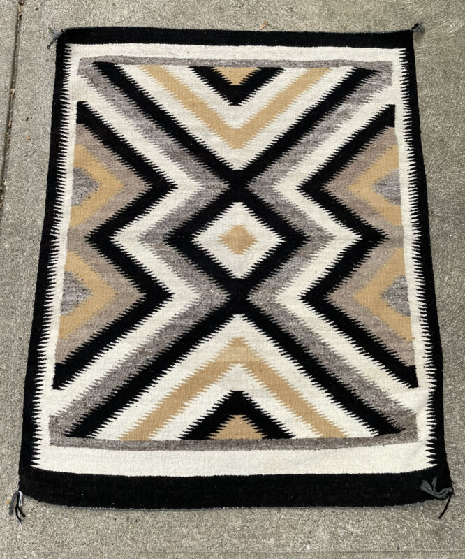 Authentic Navajo Rug woven by Annie Guss fromFred Harvey