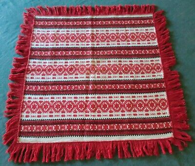 Hungarian ethnic woven table cloth 32inch x 33inch with fringe around it.