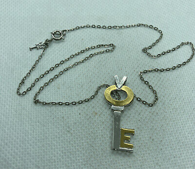 """60s -70s Jewelry – Necklaces, Earrings, Rings, Bracelets Vintage 1960s Silver/goldtone Key Necklace 1.45""""Key 15"""" Chain By Crown Trifari $29.99 AT vintagedancer.com"""