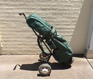 Golf clubs, golf bag, wheeled hand cart