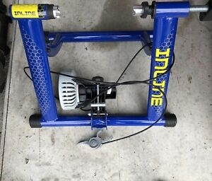 Barely used collapsible, inline bike trainer. W/hand controls!
