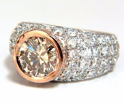 GIA Certified 3.08ct. Fancy light brown round cut diamond ring 14kt + 1