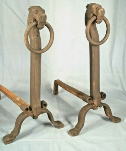 A RARE PAIR OF EARLY 20th CENTURY FOLK ART DOG HEAD CAST IRON ANDIRONS