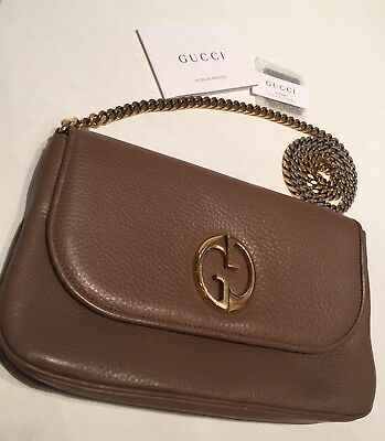 421a9feadfe5 Authentic Gucci 1973 Taupe Leather Gold Chain Cross Bag