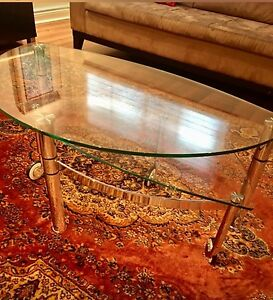 Glass coffee table with stainless steal base