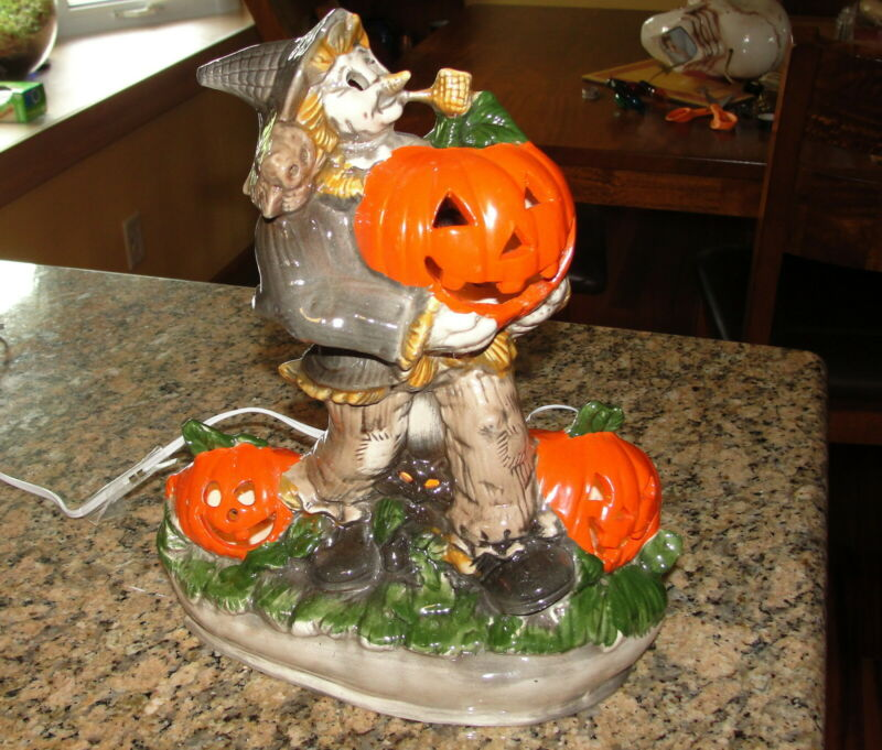 Ceramic Lighted Scarecrow Holding Pumpkin with Black Cat Halloween Light