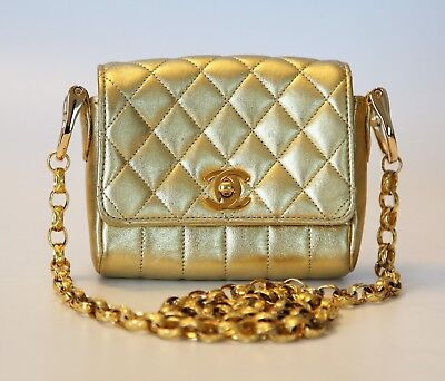 Auth Chanel gold leather classic flap mini cross body bag purse