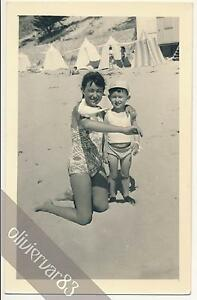 """Teen girl in swimsuit with dove on arm and little boy - vintage photo beach - France - Commentaires du vendeur : """"Good. See scan for condition."""" - France"""