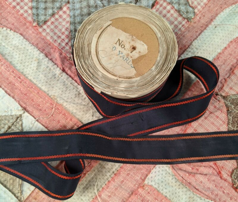ANTIQUE VICTORIAN 19TH CENTURY NAVY SILK RIBBON WITH RED PATTERNED EDGING 17+YDS