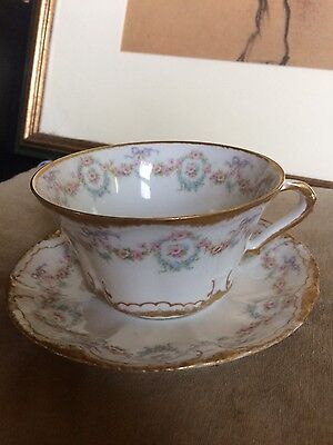 Theodore Haviland Limoges Schleiger Cup and saucer. Gold Roses and bows