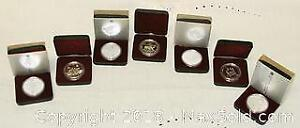 7 Canadian Cased Silver Dollar Coins