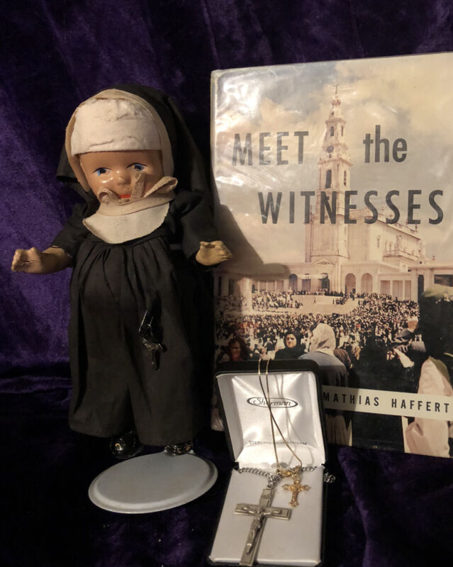 Vintage composition nun doll, Gold & Sterling crucifixes Meet The Witnesses Book