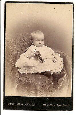 Vintage cabinet card small child Boy Girl? and stuffed bird toy. Brooklyn N.Y.
