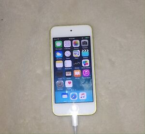 Yellow ipod 5, 32 GB with white case