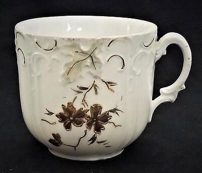 (Mustache CUP, porcelain, Germany, raised gilt floral, leaf, c1880, 3.25
