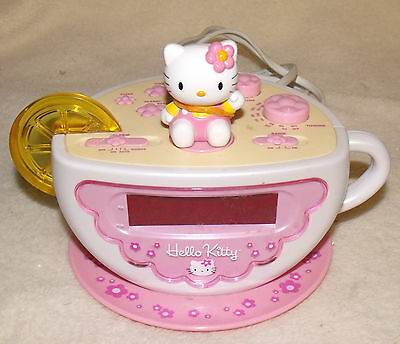 hello kitty clock radio pre-owned very good working condition