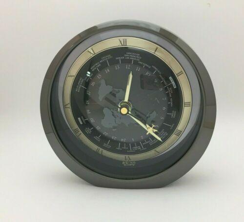 Rare Silver Seiko Quartz World Clock w Flashing Airplane Second Hand (QQZ695K)