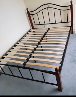 Queen bed frame and slates. Disassembled ready to move. May deliv