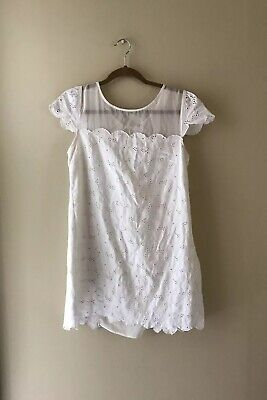 Free people White brown eyed girl eyelet mini dress Sz Small Lace Bow