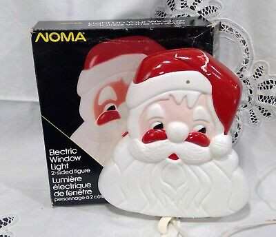 Vintage Noma Christmas Window light up Santa face. Plastic. Double sided.
