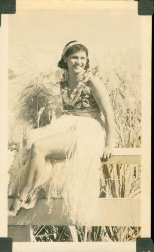 1930s  pretty Hula Girl sitting on fence Hawaii Photo